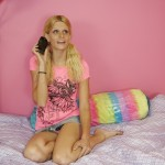 Blonde teen talking on the phone giving an upskirt view