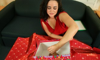 Michelle Maverick strokes the cock she is given for Christmas